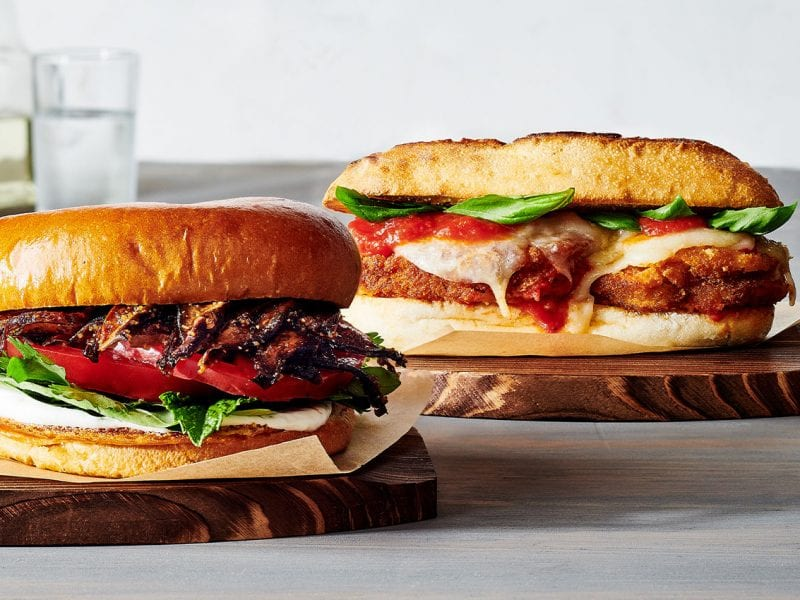Two plant-based sandwiches filled with veggies.