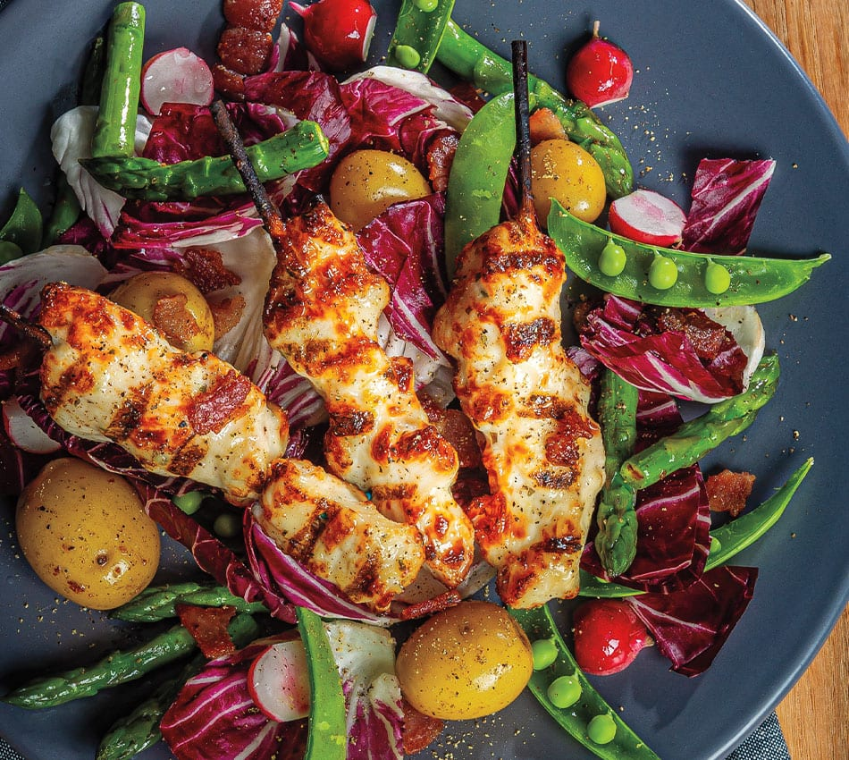 Bacon-Basted Chicken Breast Skewers Over Spring Salad