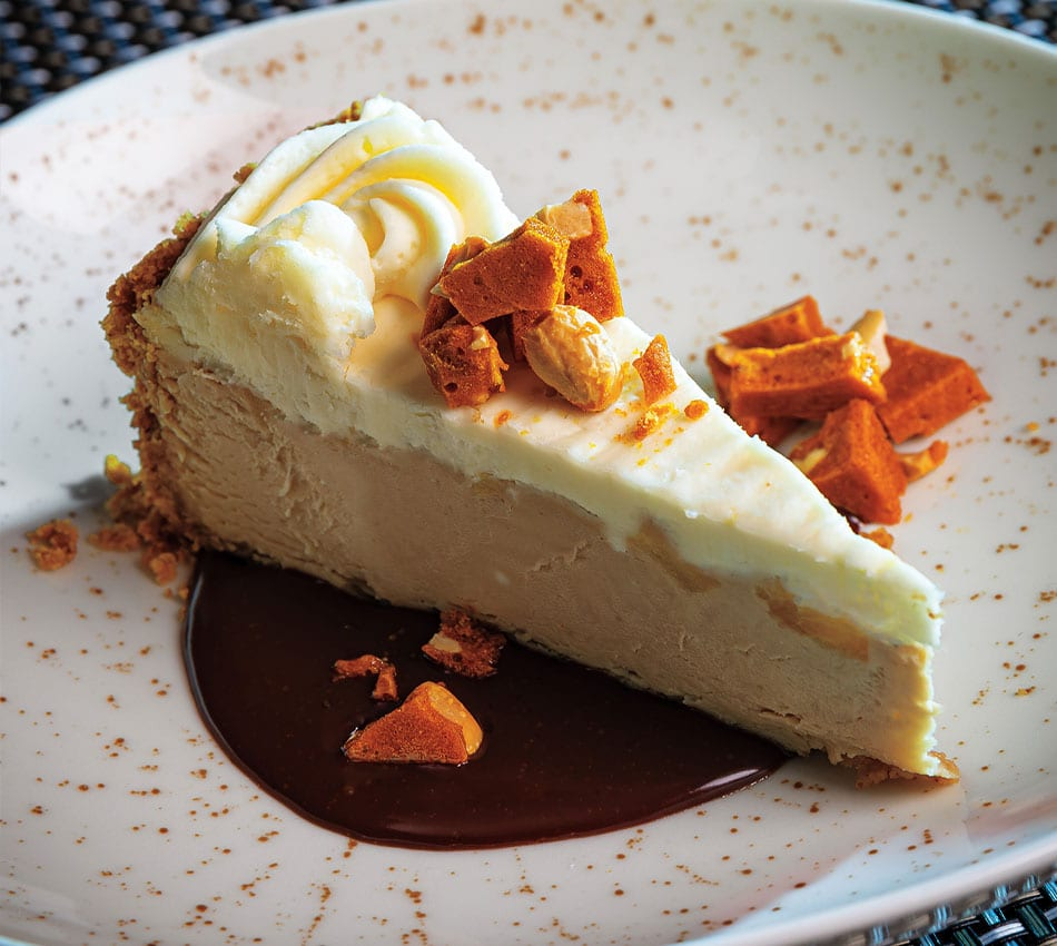 Caramel Apple Cheesecake With Chocolate Root Beer Sauce and Salty Peanut Ginger Brittle