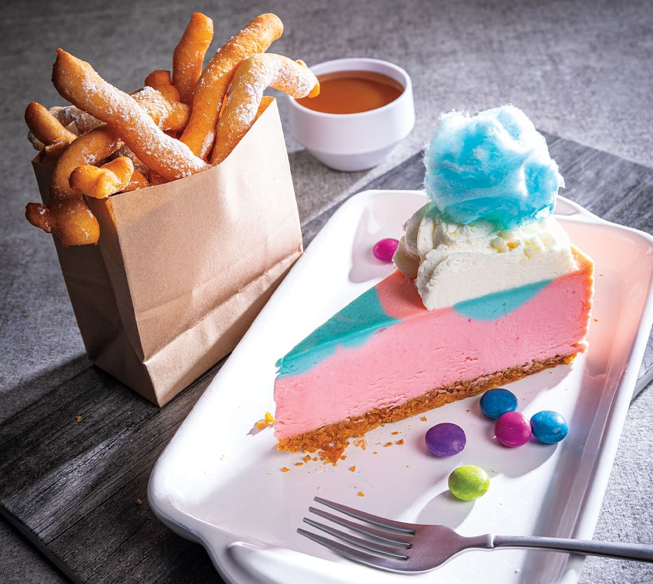 Cotton Candy Cheesecake With Funnel Cake Fries and Butterscotch Sauce