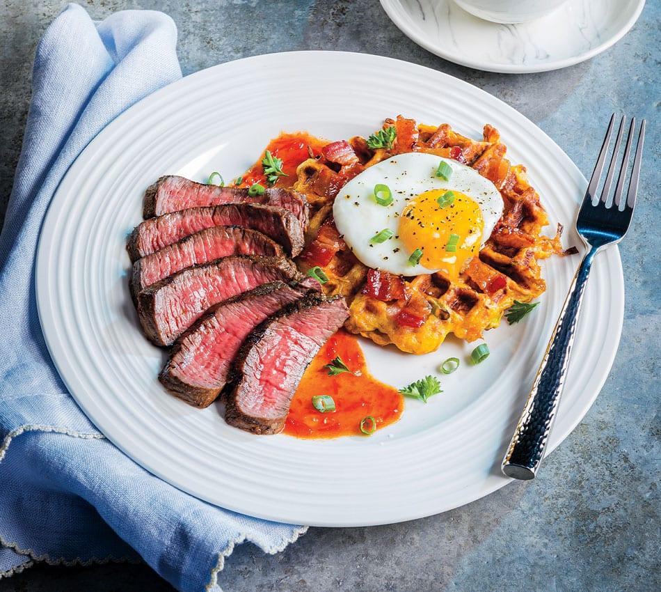 Steak and Egg-Topped Sweet Potato Hash Waffle Over Bourbon-Chile Glaze