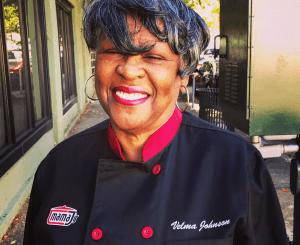 "Velma ""Mama J"" Johnson portrait in front of Mama J's Southern Food Restaurant"