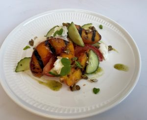 Grilled peaches with pepitas